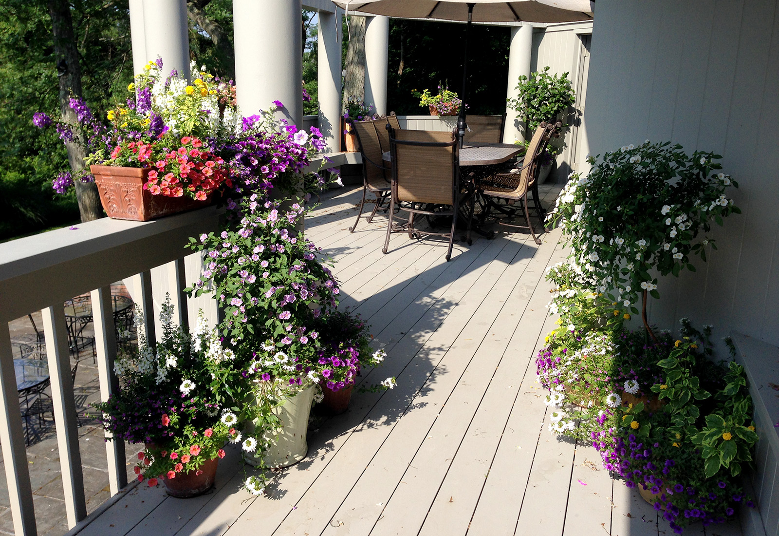 Flowering deck planters with mixed colors.