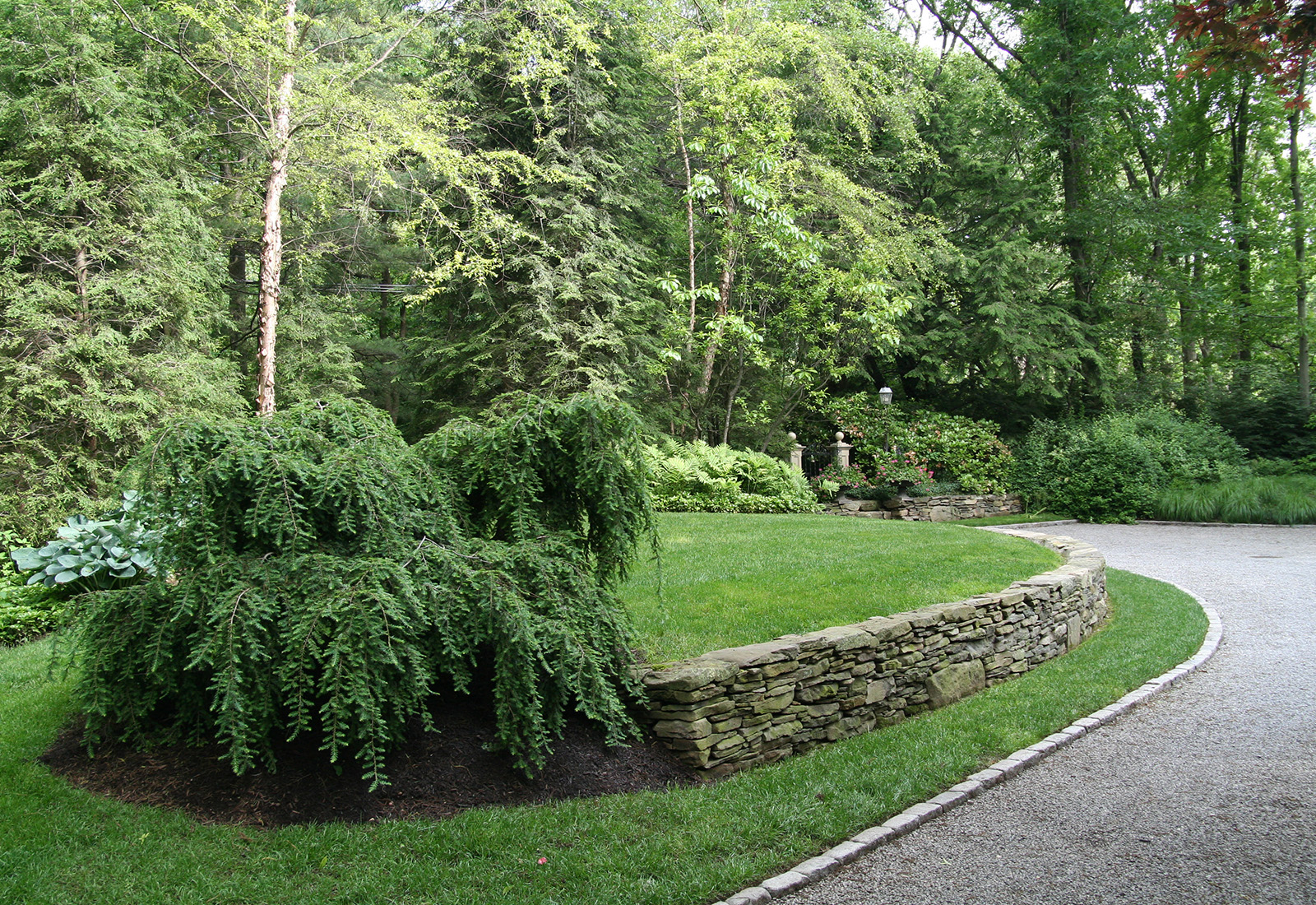 Natural stacked stone retaining wall.