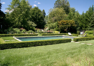 Gunite pool with a bluestone pathway, formal hedge and vegetable garden.