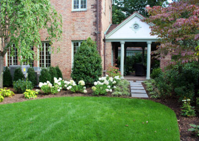 Traditional backyard planting and bluestone pathway.